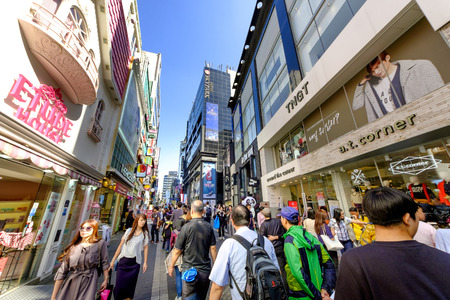 public market sign: SEOUL, KOREA - OCTOBER 3, 2015 : Myeong-Dong shopping street, Korean people tourists walking shopping the neighbourhood. It is fashionable to be the most popular. neighbourhood is must when traveling.