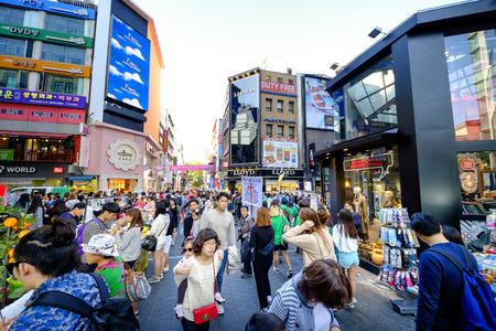neighbourhood: SEOUL, KOREA - OCTOBER 3, 2015 : Myeong-Dong shopping street, Korean people tourists walking shopping the neighbourhood. It is fashionable to be the most popular. neighbourhood is must when traveling.