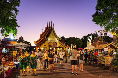 CHIANG MAI THAILAND - NOVEMBER 21 : Srisuphan temple market, Unidentified men and women tourists buy souvenirs and food. This temple is an important place to visit. Market is held every Saturday.