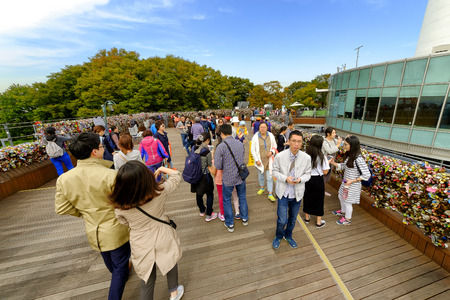 believed: SEOUL, KOREA - OCTOBER 4, 2015 : Seoul Tower, Unidentified tourists and families come to take pictures commemorate and appreciate the beauty of Seoul, an activity not to be missed when visiting here. Editorial