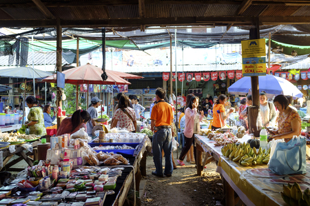lamphun: LAMPHUN THAILAND - FEBRUARY 4 : Market villagers walking street, People live in a popular local shopping to cook dinner every day. on Feb. 4, 2016 in Lamphun, Thailand. Editorial