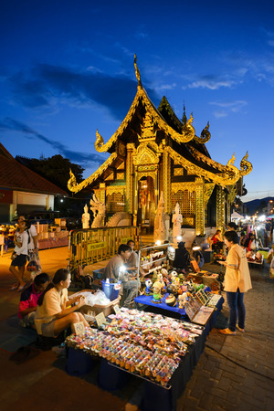 CHIANG MAI THAILAND - OCTOBER 9, 2016 : Sunday market walking street, The city center Thai temple marketing and trading of local tourists come to buy as souvenirs. this market is held every sunday Editorial