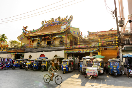 regularly: CHIANG RAI THAILAND - FEBRUARY 13, 2017 : Mae Sai market, Chinese temple near Mae Sai market, Tourists come to worship regularly on tour. and front taxi service trip.