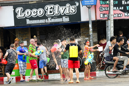 annually: CHIANG MAI THAILAND - APRIL 12, 2017 : Chiang Mai Songkran Festival. Unidentified men and women traveler like to join the fun with splashing water at Tha-Phae road, festival is held annually in April.