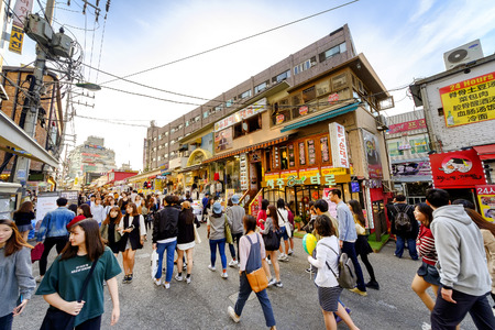 SEOUL, KOREA - OCTOBER 4, 2015 : Hongdae shopping street, Korean people tourists walking shopping the neighbourhood. It is fashionable to be the most popular. neighbourhood is must when traveling. Redakční