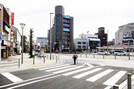 CHIBA JAPAN - MARCH 26, 2018 : Hanazakicho zone, Narita Metro Station, Japanese people are crossing the crossroads. Urban people have strict discipline to use the road, making it more secure.