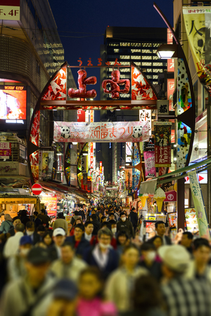TOKYO JAPAN - MARCH 30, 2018 : Ameyoko market neighborhood, Unidentified tourists walk past this area has many shops full to shopping and restaurants. One of Tokyos must-see places to visit.