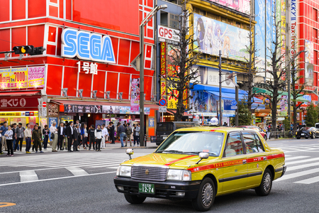 TOKYO JAPAN - APRIL 4, 2018 : Akihabara neighborhood, Unidentified tourists walk past this area has many technology shops full to shopping and restaurants. One of Tokyos must-see places to visit.
