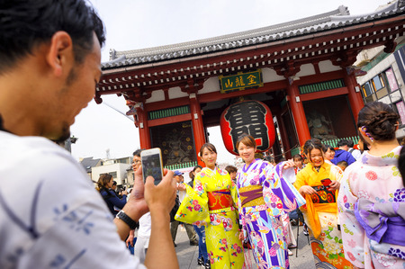TOKYO JAPAN - MAR.27,2018 : Sensoji temple at Asakusa neighborhood, Tourists wearing beautiful kimono walks inside the temple & Nakamise shopping. One of Tokyo's must-see places to visit.
