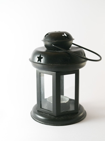 Black metal lantern on white background