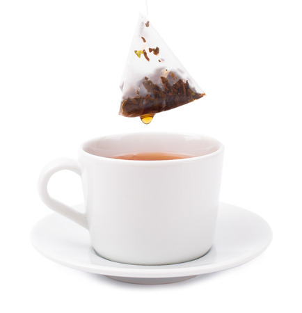 tea bag: Tea bag in a white cup on a white background