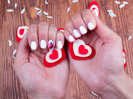 granting: Hearts in hands of the person on a table