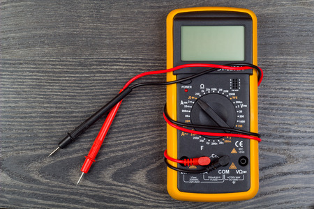 impedance: Multimeter on office table Stock Photo