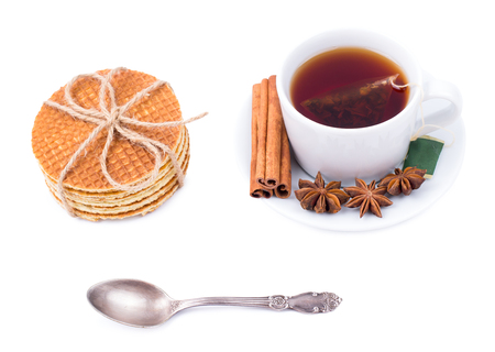 carbohydrates: Breakfast. Tea and wafers on a white background