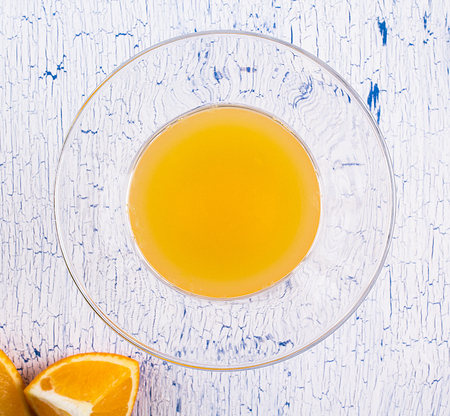 craquelure: glass of orange juice with oranges on a craquelure