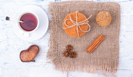 wafers: Breakfast. Tea and wafers on a table Stock Photo