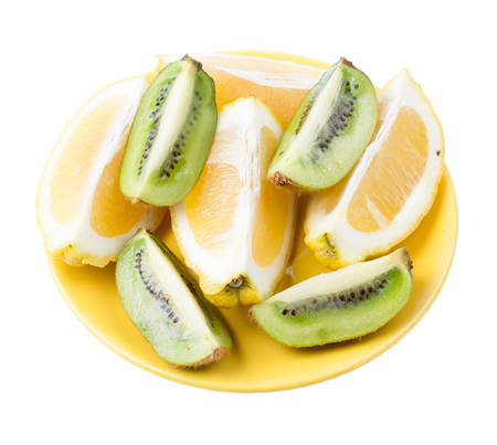 segments: Lemons and kiwi segments in a plate