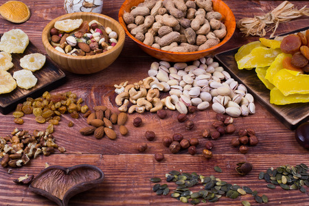 dry fruit: Nuts and dry fruit, in plates, on boards, on a table