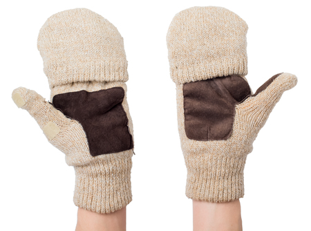 the ends: Knitted gloves with the cut-off ends on a white background