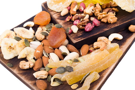 dry fruit: Mix of nuts and dry fruit on a wooden board isolated