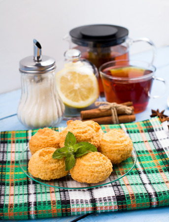 Coconut cookies and cup of tea on a table