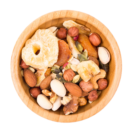 dry fruit: Mix of nuts and dry fruit in a bowl isolated