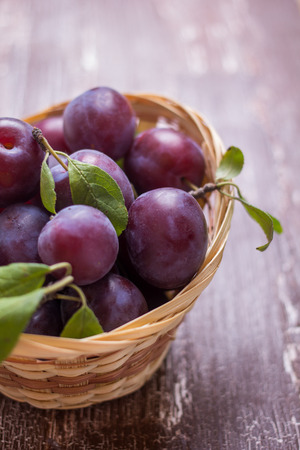 sharpness: Plum on a table with a small depth of sharpness Stock Photo