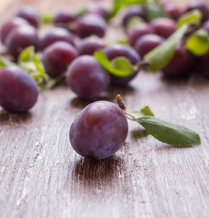 Plum on a table with a small depth of sharpness Stock Photo