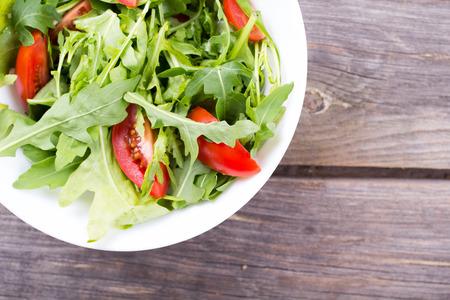 Salad arugula and cherry tomato on a table