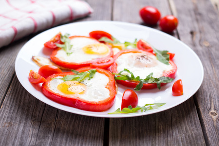 sharpness: Eggs in pepper on a plate on a table, with a small depth of sharpness