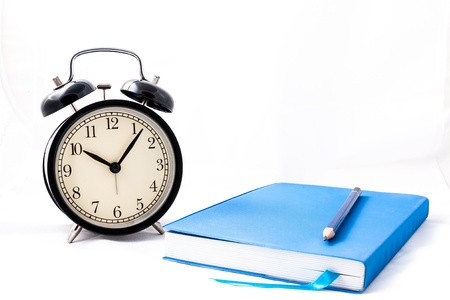 clock and book in isolated photo