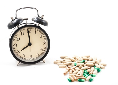 pm: medicine with 8 am or 8 pm clock Stock Photo