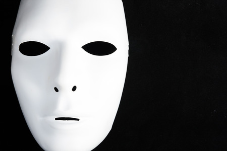 white mask in black isolated