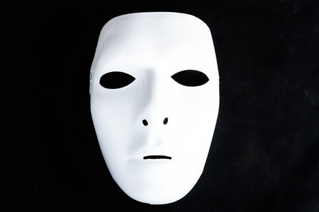 white mask in black isolated photo