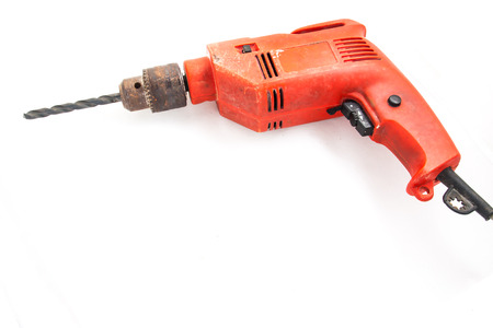 orange electric drill in isolated photo