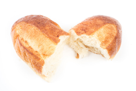 Bread rip on white isolated photo