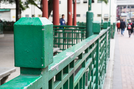 Green fence in the street photo