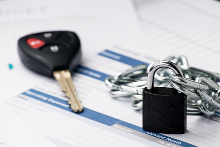 Chained lock signing a contract when you buy a car document is mock-up photo