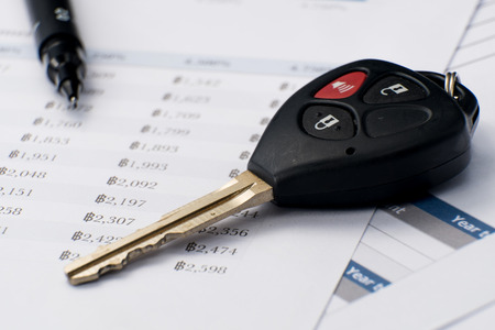 signing a contract when you buy a car.car key document is mock-up photo