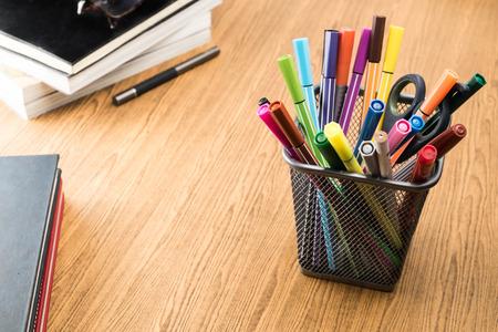paper and pen: education stuff on wooden table.pen ,colour pen ,book