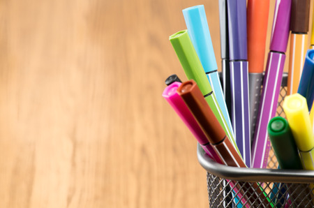 blue pen: Colorful pen in metal pen pot Stock Photo