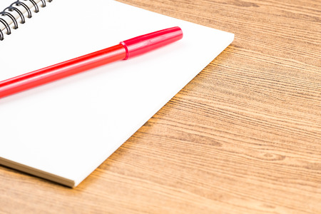 red pen: notebook and red pen on wooden table.education Stock Photo