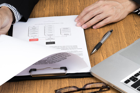 office documents: businessman hand checking marketing document Stock Photo
