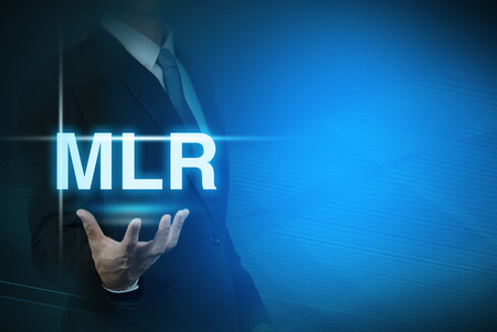 bank rate: businessman with MLR word stand for Minimum Loan Rate on abstract background .bank interest