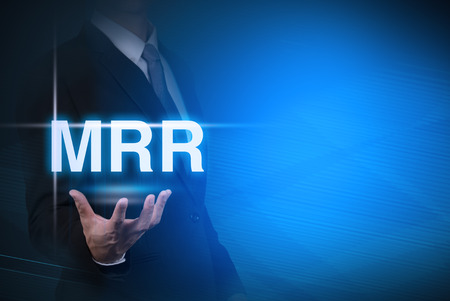 bank rate: businessman with MRR word stand for Minimum Retail Rate on abstract background .bank interest