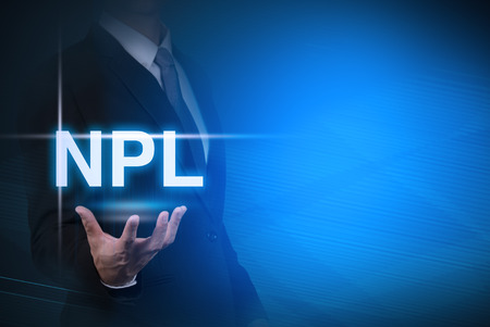 stylized banking: businessman with NPL word stand for Non Performing Loan on abstract background .key for business