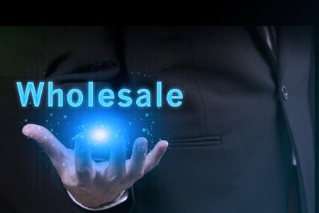 businessman showing wholesale word.marketing concept.