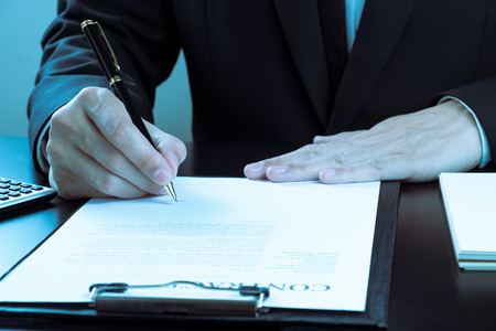 businessman signing marketing contract.