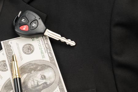 car key business pen and money on black suit for financial .car rent