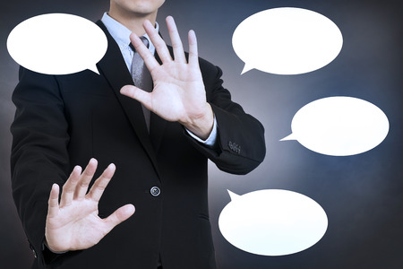 defend: businessman defend him self with speech bubble.concept